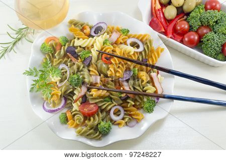 Pasta Meal Cooked With Vegetables With Fresh Vegetables Served With Chopsticks And A Glass Of Wine