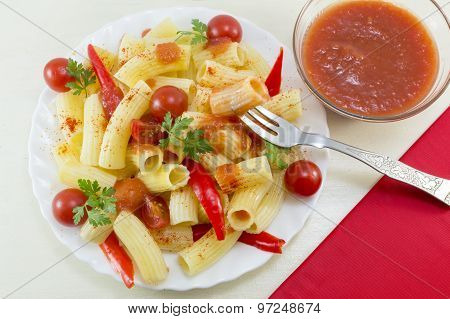 Macaroni With Cherry Tomatoes, Parsley And Red Pepper Served With A Tomato Sauce And A Fork, Close U