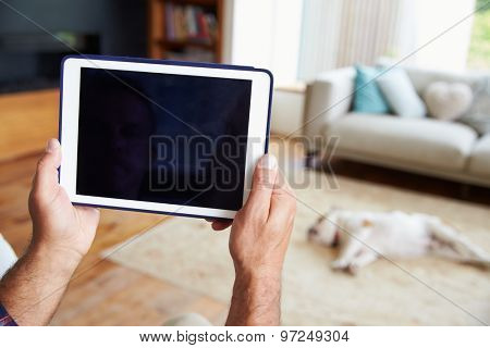 Close Up Of Man Using Digital Tablet At Home