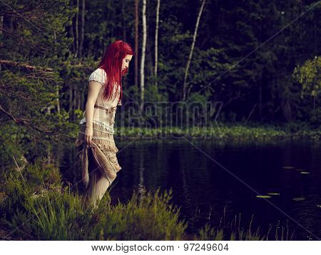 Attractive Woman On The Lake