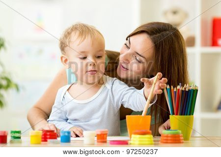 kid painting at home or day care center