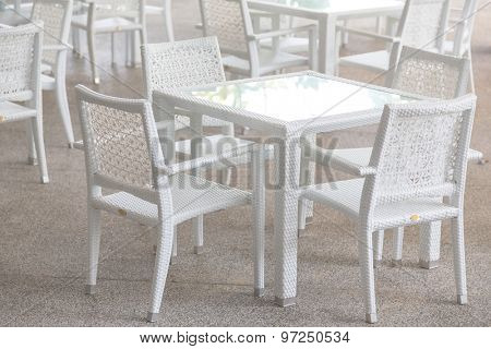 White tables and chairs in restaurant