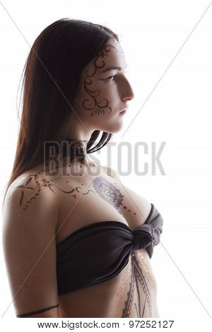 Side view of brunette with henna patterns on body