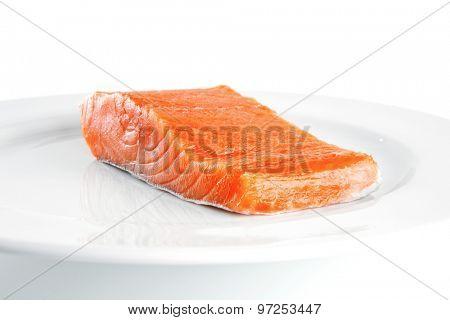 smoked fresh salmon piece on a big white dish