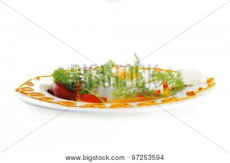 egg served on white plate with vegetables