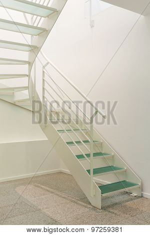 Interior of modern building, steel staircase view, white walls
