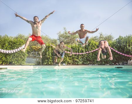 Friends Jumping In A Swimming Pool