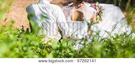 couple in love hug near blue lake