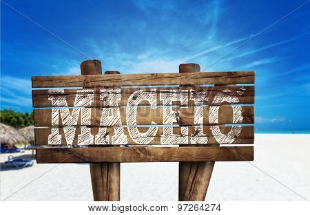 Maceio wooden sign on the beach