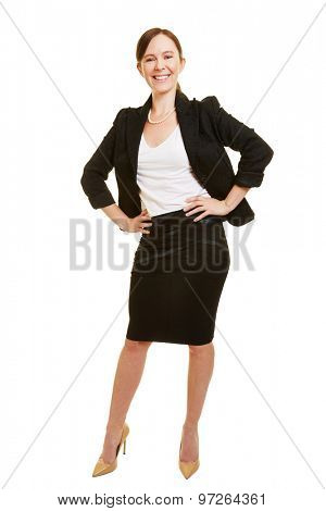 Smiling businesswoman in a business suit with her arms akimbo