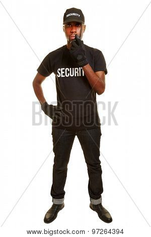 Black man as security guard talking into radio set