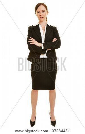 Full body shot of a businesswoman with her arms crossed