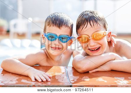 Brothers Laughing In Pool