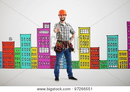 smiley builder showing thumbs up over grey wall with variegated drawing houses