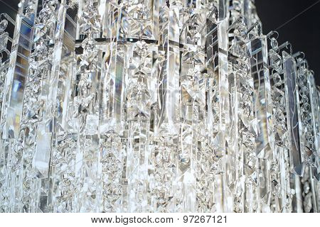 Close up on crystal of contemporary chandelier luxury interior design