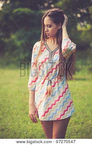 young woman in retro look hippie dress outdoor in nature