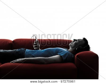 one caucasian man sofa coach listening music audio  in silhouette isolated on white background