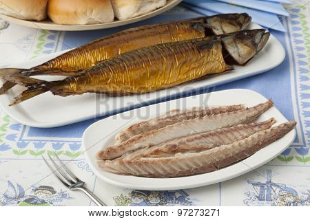 Traditional dutch fresh smoked mackerels, filleted and white rolls