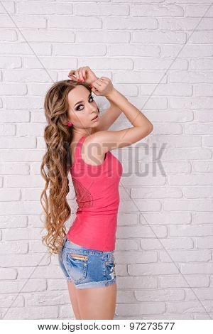 Beautiful Girl With Wavy Long Hair Standing On White Background