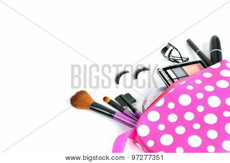 make up bag with cosmetics and brushes isolated