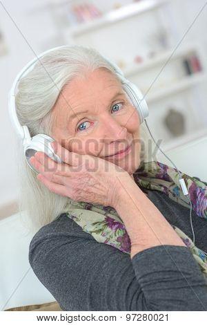 Senior lady wearing headphones