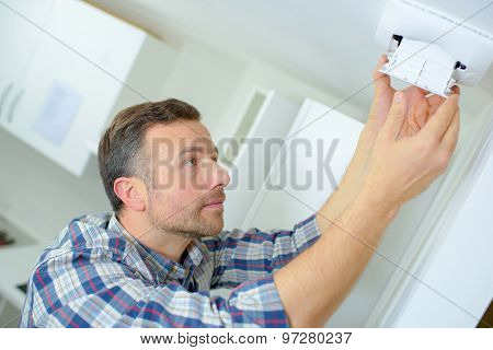 Man fitting an air vent