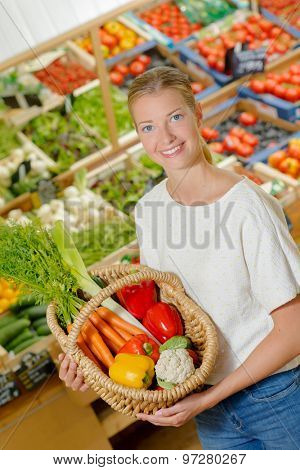 Woman by a vegetable stand