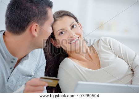 Couple with computer and credit card