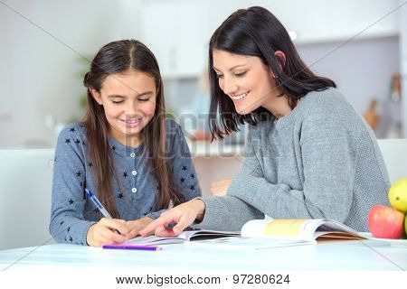 Mom helping her daughter do her homework