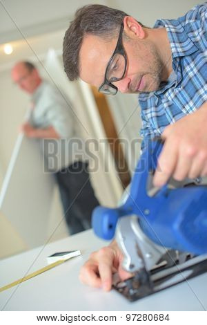 Handyman using a band saw