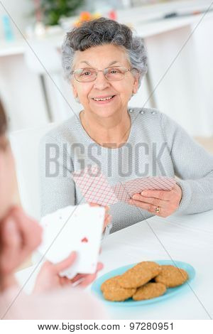 Old lady playing cards