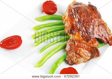 beef meat served on white plate with beans