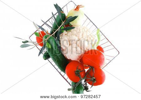 ripe vegetables in metal store basket on white