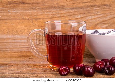 Cup Of Tea Sweet Cherry And Blueberry In White Bowl On A Wooden Background