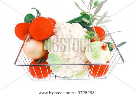 metal basket with vegetables on white background