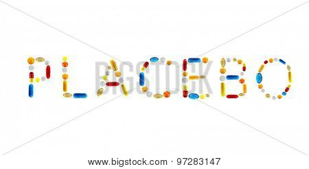 The word Placebo made with pills isolated on white
