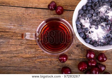Sweet Cherry And Blueberry In White Bowl On A Wooden Background