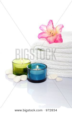 Gladiola, Towel, Candles And River Stones