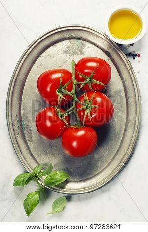 Tomato and fresh italian ingredients on vintage plate