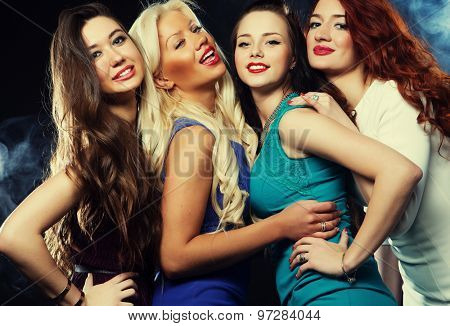 Group of girls  friends having fun on a disco