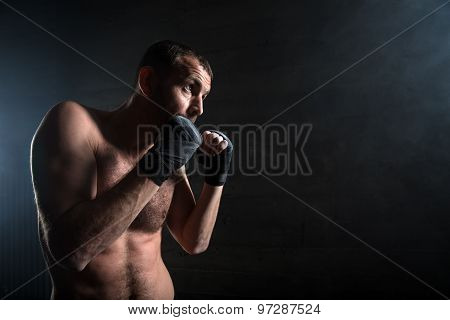 young boxer in light weight with bare-chested