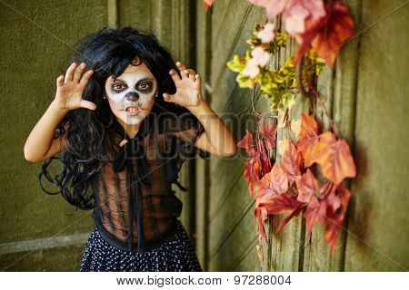 Furious girl in wig and Halloween attire