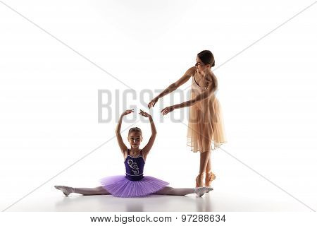 The little ballerina dancing with personal ballet teacher in dance studio
