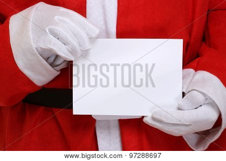 Santa Claus Holding Empty Christmas Card With Copyspace