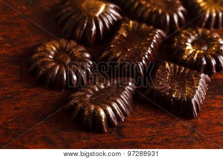 chocolate sweets with edible golden powdeer