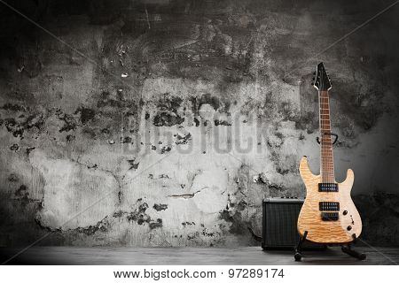 Modern electric guitar on dark background