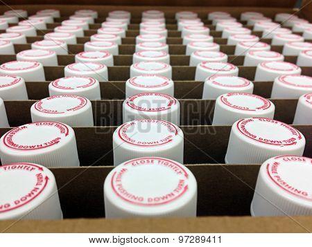 prescription lids and vials in a box