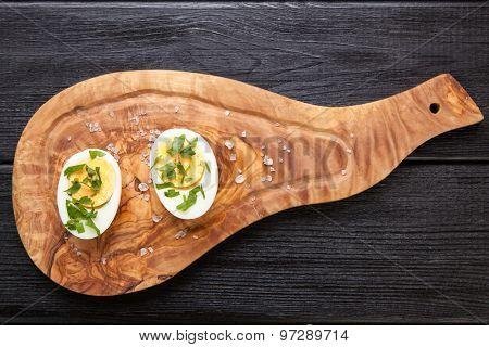 Boiled eggs on a cutting board.