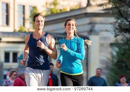 Couple running for Sport in inner city of Dresden