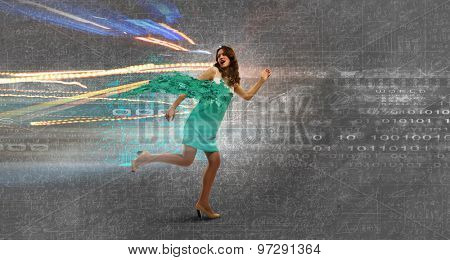 Young businesswoman in dress running in a hurry
